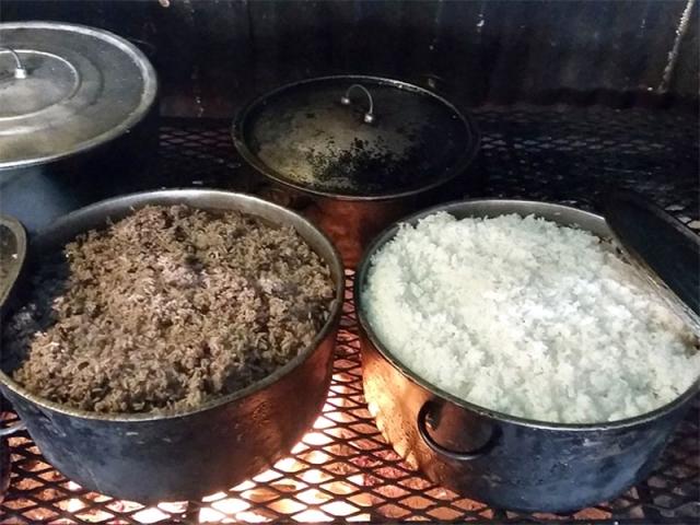Baking Rice Over El Fogon