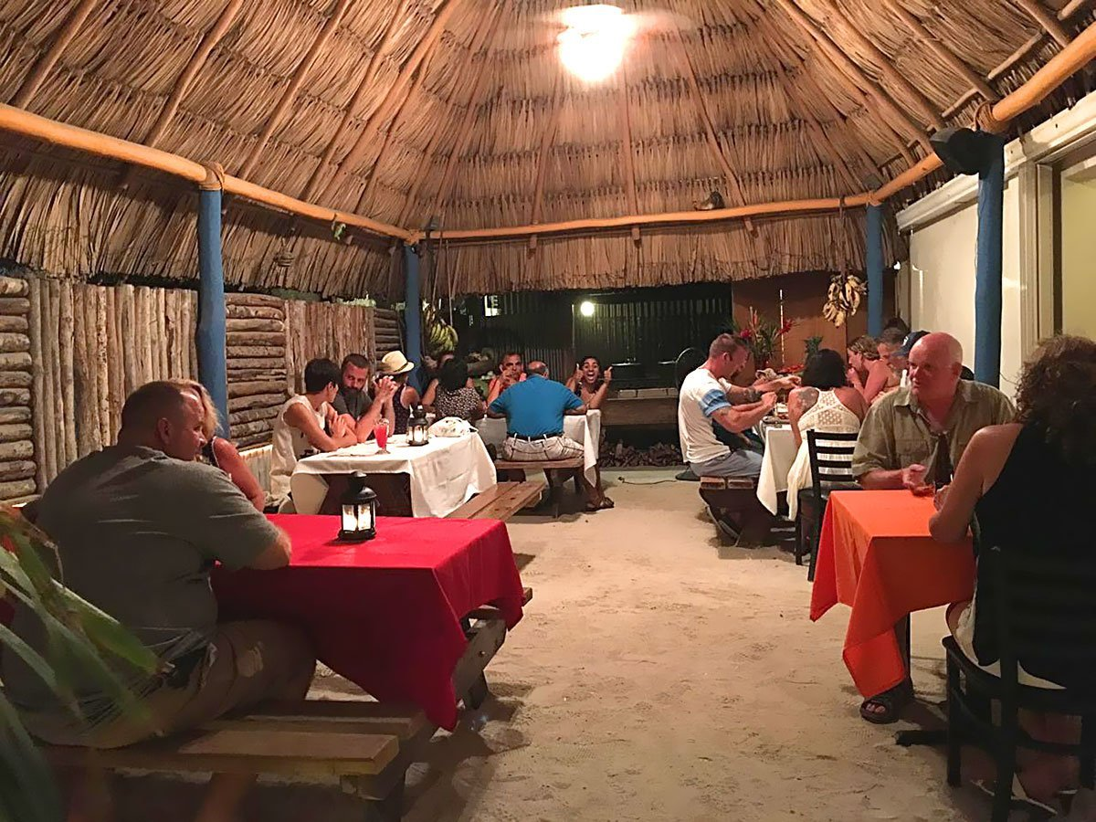 People Enjoying Belizean Food at El Fogon Restaurant